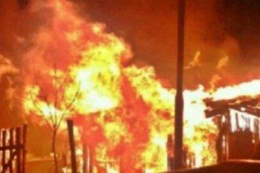 Un herido de arma de fuego  y una vivienda incendiada en una pelea de vecinos